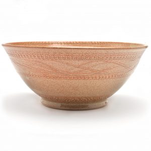 wheel thrown brick colored ceramic bowl,