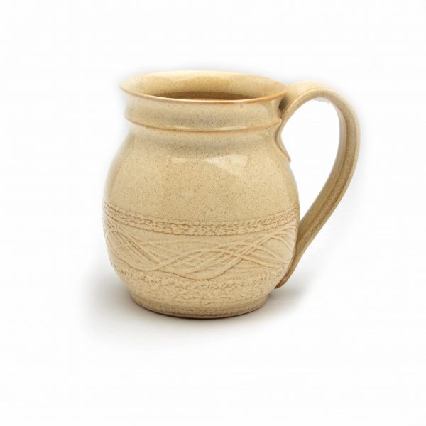 cream colored handmade mug with pulled handle and decoration carving on bottom, nc clay artist, cheap pottery, sale pottery, nc clay