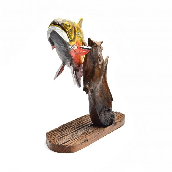 front view of carved wooden fish, painted and hand carved traditional wood carving, folk art