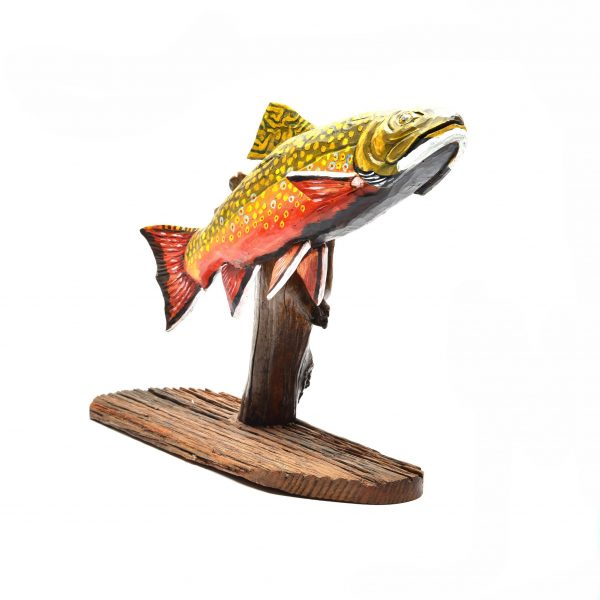 traditional wood carving, painted and carved wooden fish on log