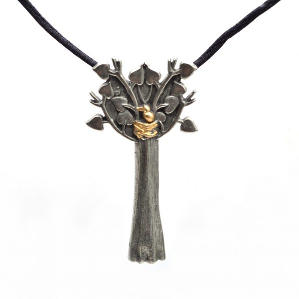 large pewter tree of life necklace with gold bird next on black silk rope