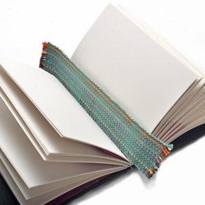 woven bookmark inside journal