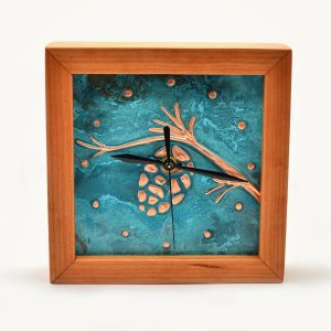 Patina face with copper pinecone clock