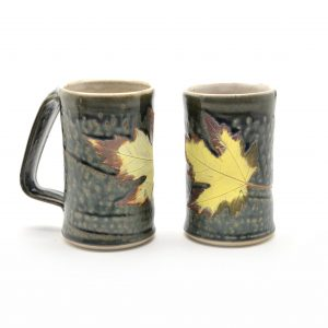 Wheel thrown mug with green ash glaze and yellow and brown leaf, unique handle, unique affordable mug made in nc