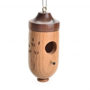 Wood turned handmade hummingbird house, dark and light wood with hole, perch, and wheat carving