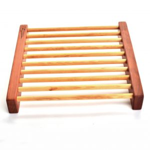 Handmade wooden pie cookie cooling rack with 2 large side pieces and strips going across to hold a pie.