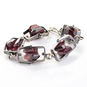 silver fabricated bracelet with large garnet gemstones, kinetic jewelry, statement bracelet, nc jeweler, asheville silver jeweler,