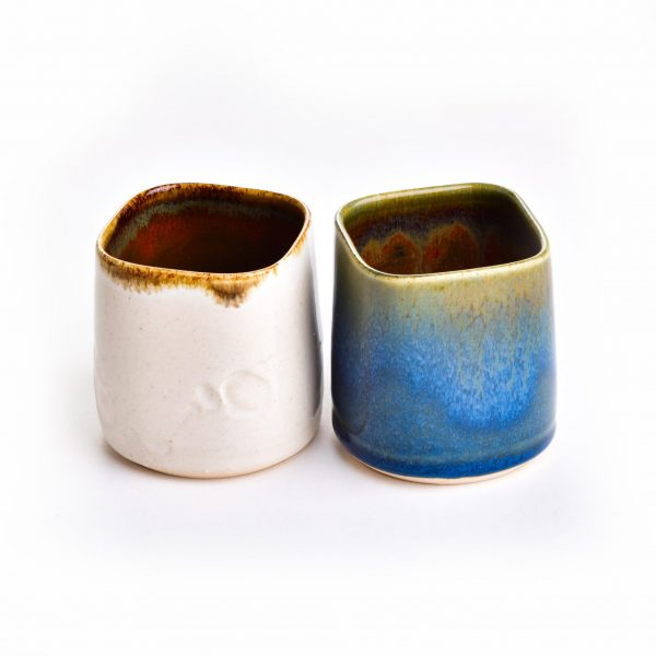 short squared wheel thrown cups in blue and white with brown interior and squared top