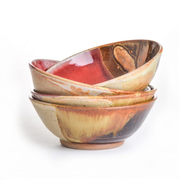 tan red brown and black wheel thrown cereal bowl with trimmed foot