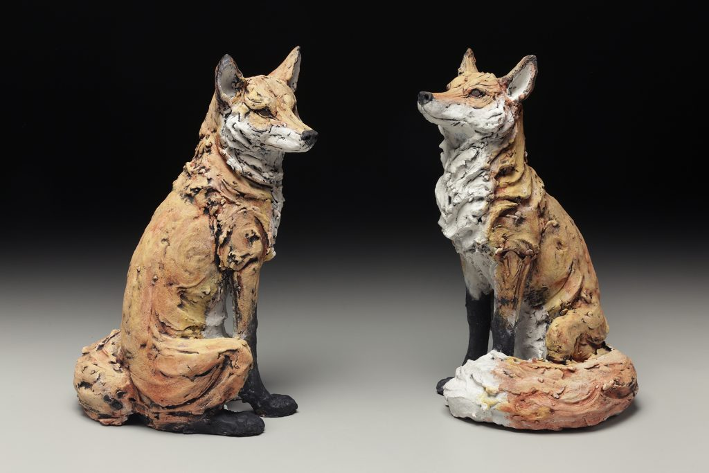 handcrafted clay sculpture painted foxes in biltmore craft gallery, asheville nc