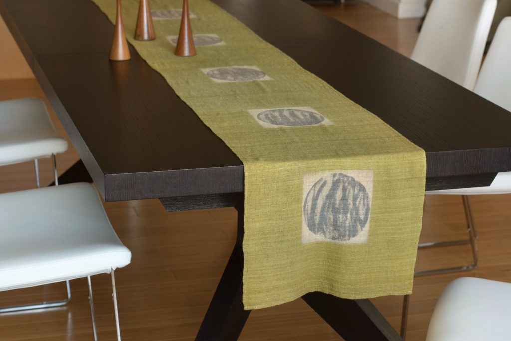 image of handmade hand dyed table runner green with white square and gray dots
