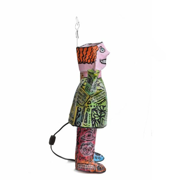 side view of paper mache lamp with flower on head