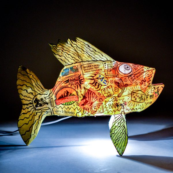 light up fish lamp with black writing