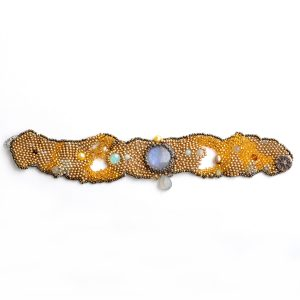 top view of small woven beaded bracelet with round labradorite stone and gray drop bead