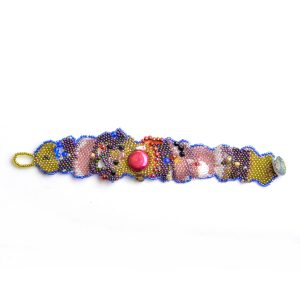 top view of rainbow beaded bracelet with red pear pink green and purple beads with button closure