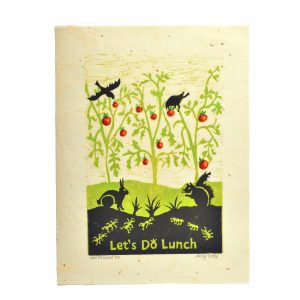 handmade wood cut of a tomato garden with crows rabbit squirrel and ants and the words Let's do lunch