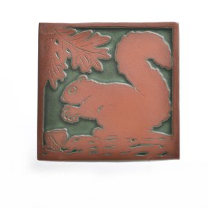 Green and red square ceramic squirrel tile trivel