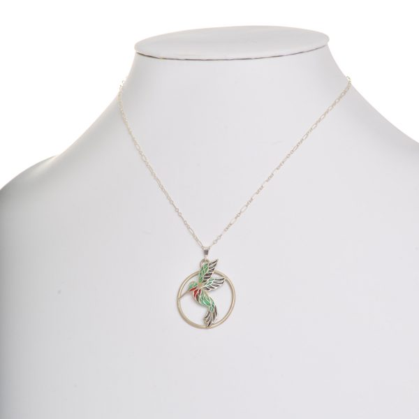 3-d stained glass hummingbird necklace, hummingbird popping out of a round circle of silver