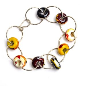 yellow brown and white circle glass bead bracelet with silver round links, georgia glass jewelry artist