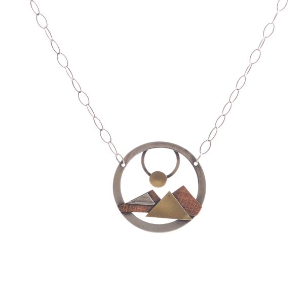 open circle necklace mixed metal with mountain scene with sun, gold copper and silver textured metal