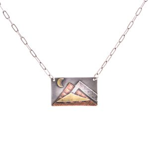 small sterling silver rectangle pendant with copper brass and gold mountain scene