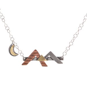 silver bar with mixed metal mountain landscape with hanging moon on chain, silver copper and brass mountain jewelry