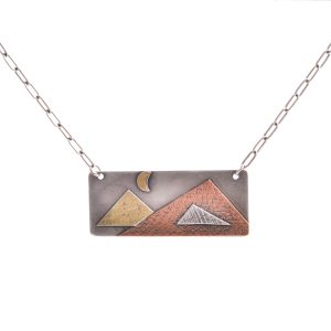 recatangle necklace with mountain and moon scene, mixed metal mountain jewelry, copper brass and sterling silver