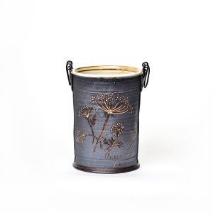 black bucket with drawing of queen anne's lace with black exterior and off white inside with metal handles