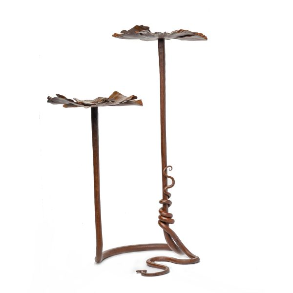 side view of metal rusty flower sculpture by Susan Hutchinson, 2 flowers on vine base with rusty flowers