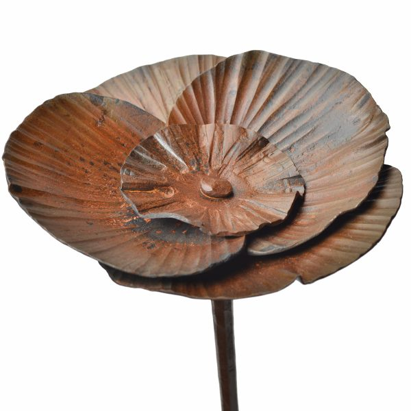 detail of steel flower stand, layered metal petals on a stem
