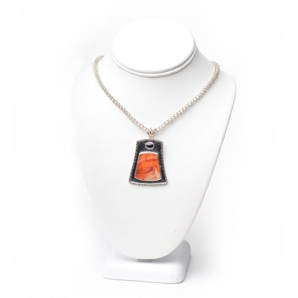 handmade handwoven silver chain with textured silver pendant with red stone carnelian with black onyx oval stone by Joseph Rhodes on bust
