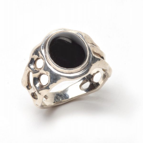 black onyx and silver ring, handmade ring size 8, cast silver band is organic with holes and a round black onyx stone, joseph rhodes