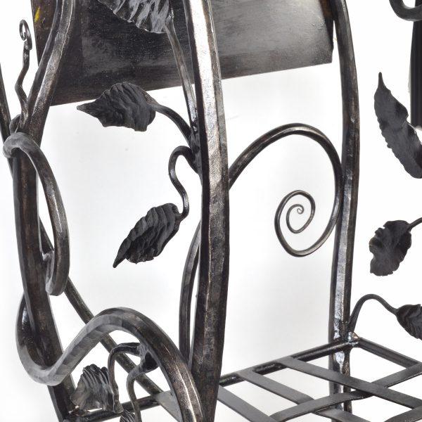 detail of handmade steel shelf with vines leaves and flowers, handmake metal furniture made in nc, north carolina metal furniture