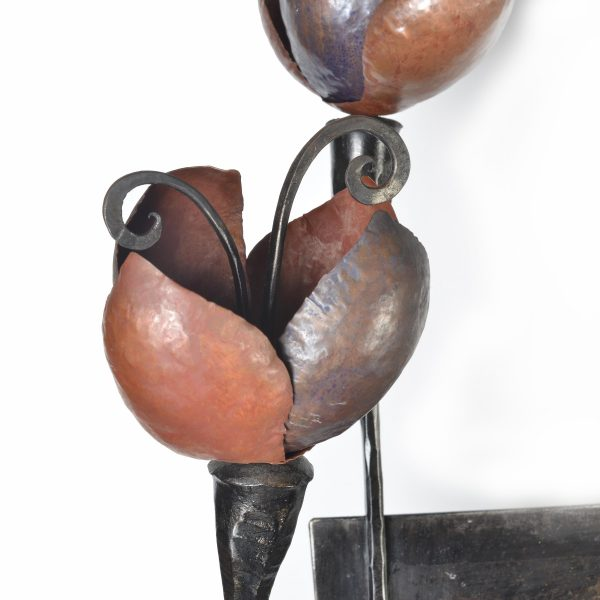 detail of copper and steel self unit, metal flower detail