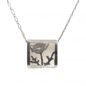 sterling silver necklace with outline of poppy flower