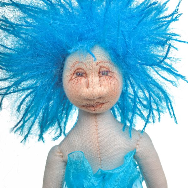 detail of handmade mermaid doll with blue hair , handpainted face