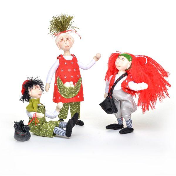 group of handmade holiday elves having a snow ball flight, 2 girls and 1 boy elf, holiday handmade room decor, southern dollmaker