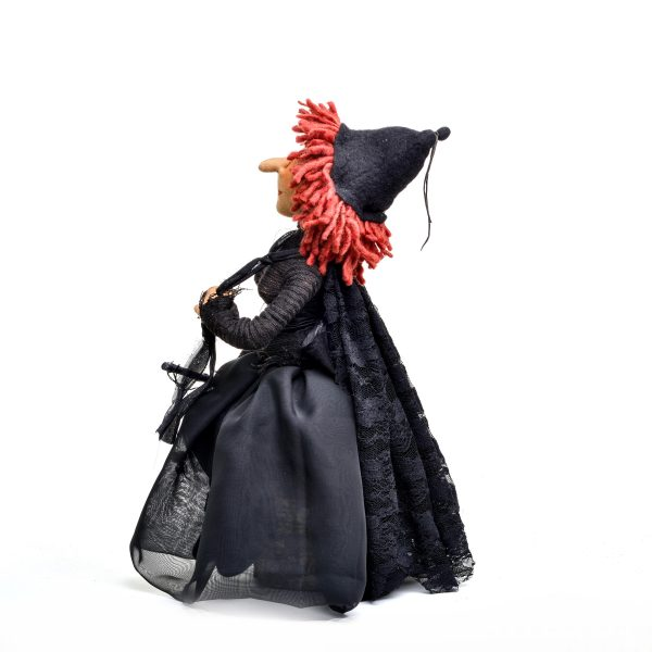 other side view of wilma witch handmade doll, black clothes on handmade witch with red hair