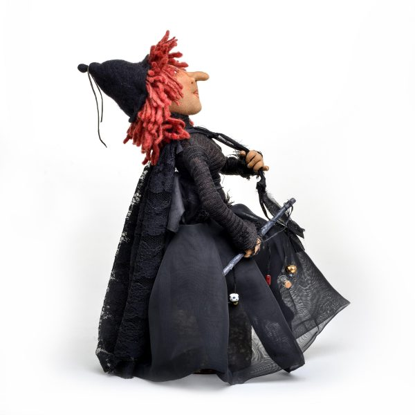 side view of handmade witch doll by Charlie Patricolo. Handmade fiber doll, halloween decor, southern craft, campbell folk school doll maker, handmade doll maker