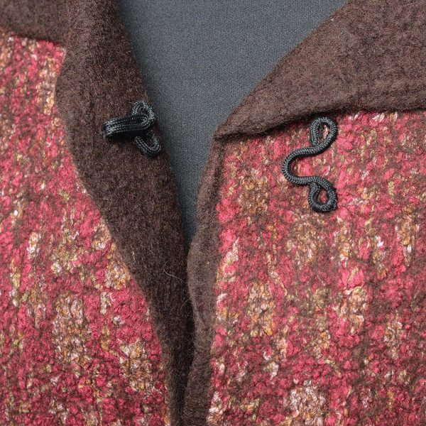 detail of clasp on handmade coat