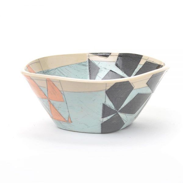 outside view of handmade ceramic bowl with light blue black and orange patterns