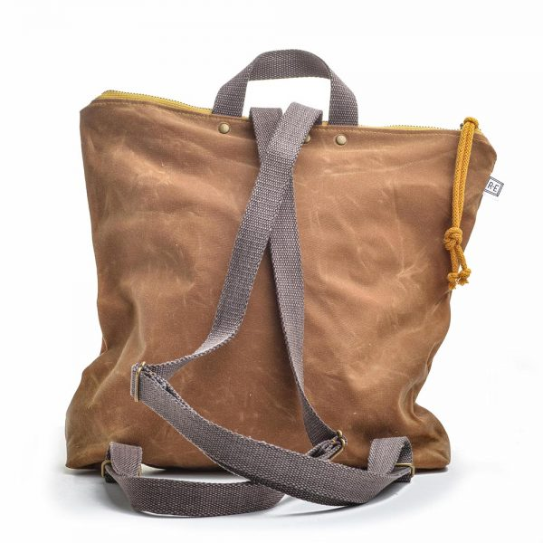 back view of waxed canvas backpack with cotton straps