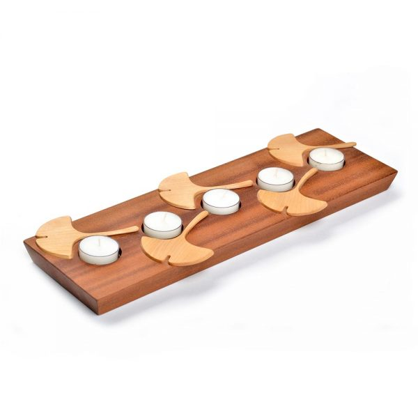 diagonal view of rectangle wooden tea light holder with gingko leaf decoration