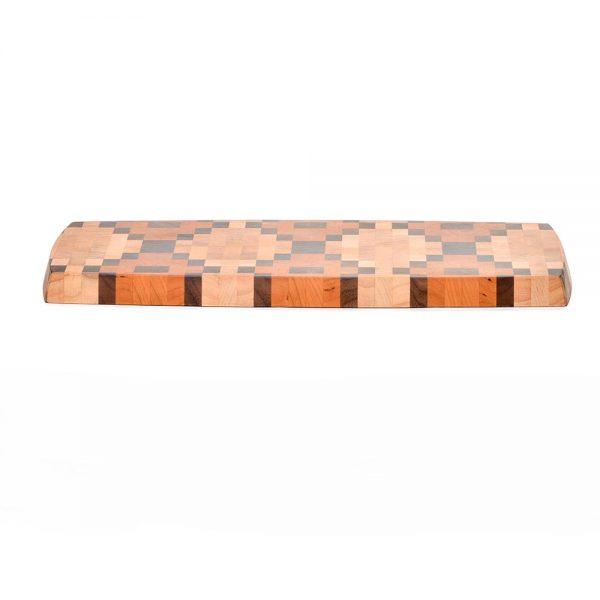 side view of wooden end grain cutting board with copperhead design, handmade cutting board, folk art center