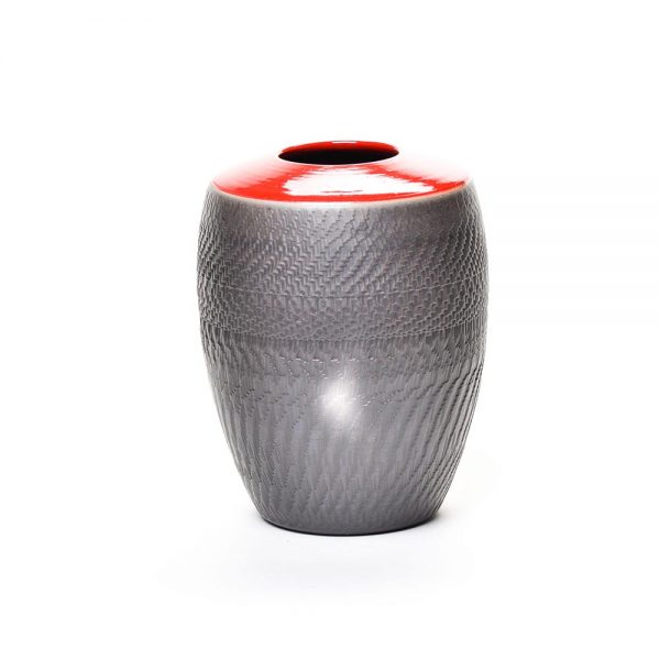 small red and black raku vase