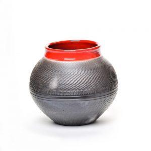 red and black raku vase