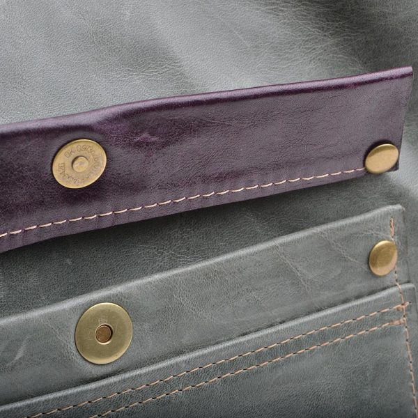 detail of recycled leather hobo bag pocket