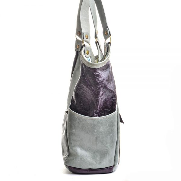 side view of purple and blue hobo leather bag