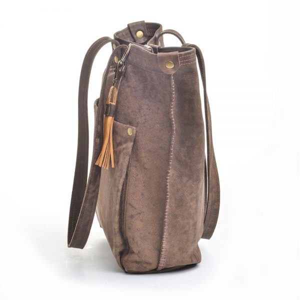 side view of dark brown leather bag with tan tassel keychain