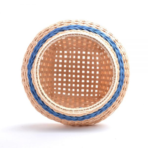 inside view of natural basket with blue stripes with pointy bottom